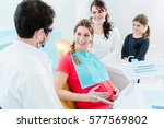 pregnant woman at dentist... | Shutterstock . vector #577569802