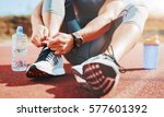 Small photo of Tying sports shoe. A young sportsman getting ready for athletic and fitness training outdoors. Sport, exercise, fitness, workout. Healthy lifestyle
