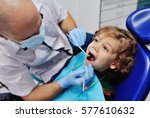 male dentist examines the teeth ... | Shutterstock . vector #577610632