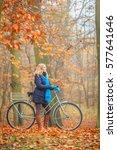 happy active woman riding bike... | Shutterstock . vector #577641646