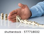 hand stopping domino falling... | Shutterstock . vector #577718032