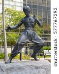 Small photo of HONG KONG CIRCA FEBRUARY 2017. Bruce Lee Statue in Kowloon Hong Kong, commemorates the consummate martial artist and American actor made famous by his martial art action films.