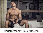 muscular  shirtless young man... | Shutterstock . vector #577786096