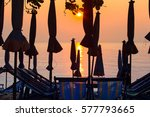 shadow of umbrellas and chairs... | Shutterstock . vector #577793665