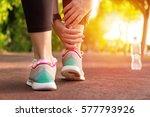 female athlete runner touching... | Shutterstock . vector #577793926