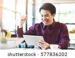 handsome business man in an... | Shutterstock . vector #577836202