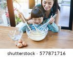 young beautiful mother teaches... | Shutterstock . vector #577871716