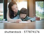 asian mother and daughter are... | Shutterstock . vector #577874176