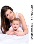 happy young mother tenderly... | Shutterstock . vector #577890685
