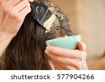 woman applying mask to hair... | Shutterstock . vector #577904266