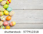 easter eggs on wooden background | Shutterstock . vector #577912318