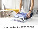 ironing clothes on ironing board | Shutterstock . vector #577985032