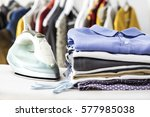ironing clothes on ironing board | Shutterstock . vector #577985038
