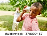 african boy calling friend with ... | Shutterstock . vector #578000452