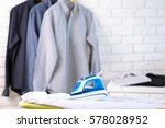 modern iron and clothes in dry... | Shutterstock . vector #578028952
