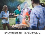 happy friends grilling meat and ...   Shutterstock . vector #578059372