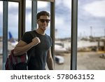 cheerful young man standing in... | Shutterstock . vector #578063152