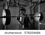 young teenage man doing squats... | Shutterstock . vector #578204686