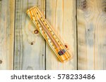 Thermometer On A Wooden...