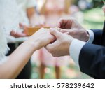 groom putting ring on bride's...   Shutterstock . vector #578239642