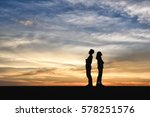 Silhouette Of Man And Women Ar...