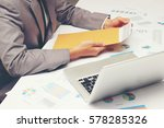 businessman open brown envelope ... | Shutterstock . vector #578285326