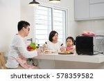 asian family enjoying and... | Shutterstock . vector #578359582