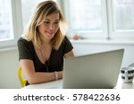 smiling woman in front of... | Shutterstock . vector #578422636
