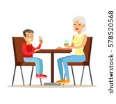 grandmother and a boy eating...   Shutterstock .eps vector #578520568