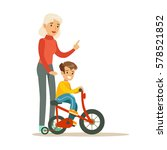 grandmother teaching boy to... | Shutterstock .eps vector #578521852
