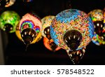 Small photo of Glass lamp adorned with glass colorful Indian style.