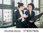 two young female colleagues... | Shutterstock . vector #578567806