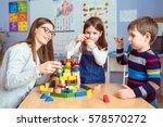 teacher and kids playing... | Shutterstock . vector #578570272