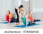 teacher helping with yoga pose... | Shutterstock . vector #578586928