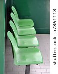 Row of green chairs in waiting area - stock photo