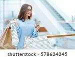 young shopper messaging in... | Shutterstock . vector #578624245