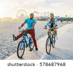 couple having fun riding bikes... | Shutterstock . vector #578687968