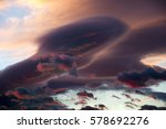 Small photo of Dramatic skies with Lenticular cloud Altocumulus lenticularis in sunset