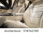 Luxury car interior with close-up on leather seats - stock photo