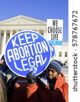 Small photo of January 22, 2009, Washington, DC USA: A pro-choice activist holding a sing for legal abortion rights in front of the US Supreme Court building during the 2009 March for life