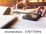 young man calculate finance...   Shutterstock . vector #578775496