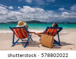 couple on tropical beach in... | Shutterstock . vector #578802022