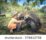 Child Touching Aldabra Giant...
