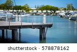 jetty in a luxuries marina with ... | Shutterstock . vector #578878162