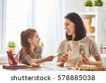 happy family. mother and... | Shutterstock . vector #578885038