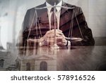 Small photo of justice and law concept.Male lawyer in the office with brass scale on wooden table with london city background,double exposure