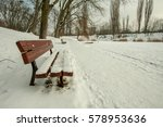 Snow Covered Benches Standing...