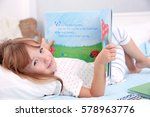 little cute girl reading book... | Shutterstock . vector #578963776