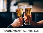 cheers. close up of two men in... | Shutterstock . vector #578983168