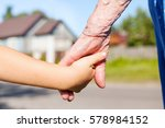 grandmother taking hand of... | Shutterstock . vector #578984152